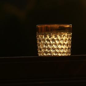 západ slunce ve sklenici od piva
