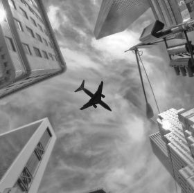 Plane over skyscrapers, New York City, Fifth avenue