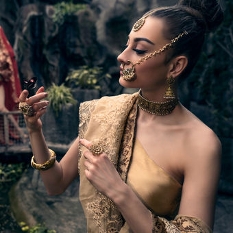 Indian girls in Buddhist temple of butterflies