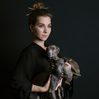 Woman with italian greyhounds