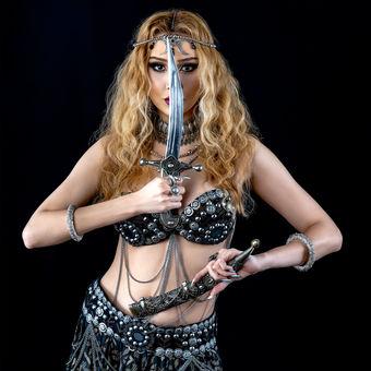 Oriental dancer with a dagger