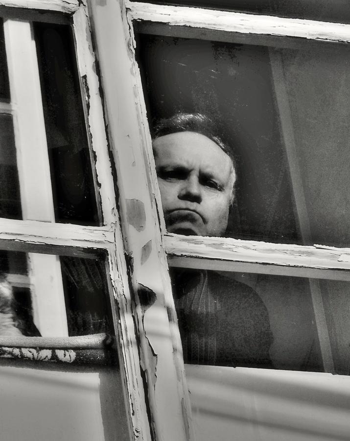 Nasratý pán za oknem