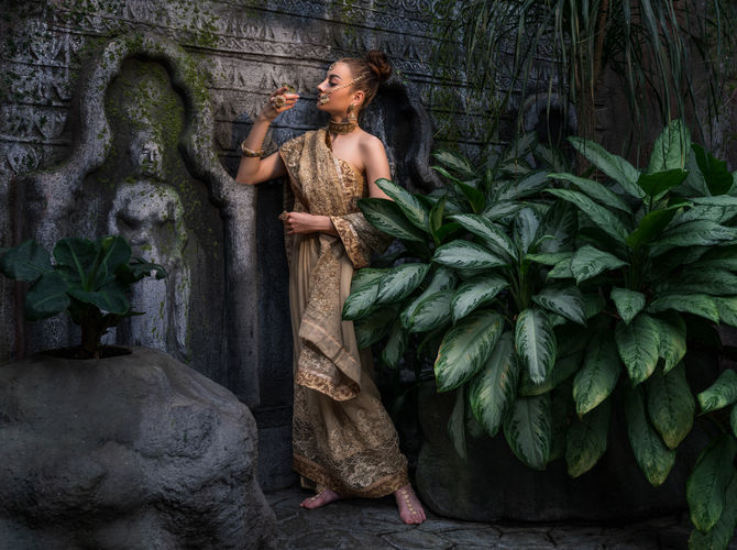 Indian girl in Buddhist temple of butterflies