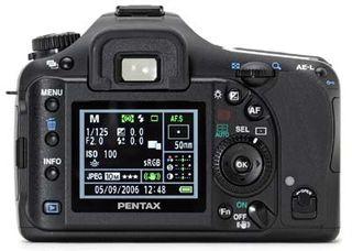 Pentax K10D + DA 18-55 mm + D-BG2 + D-Li-50