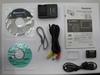 Obsah balení Panasonic Lumix DMC-TZ7 stříbrný + úsporná žárovka + digitální LCD budík zdarma!