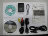Obsah balení Panasonic Lumix DMC-TZ6 stříbrný + úsporná žárovka zdarma!