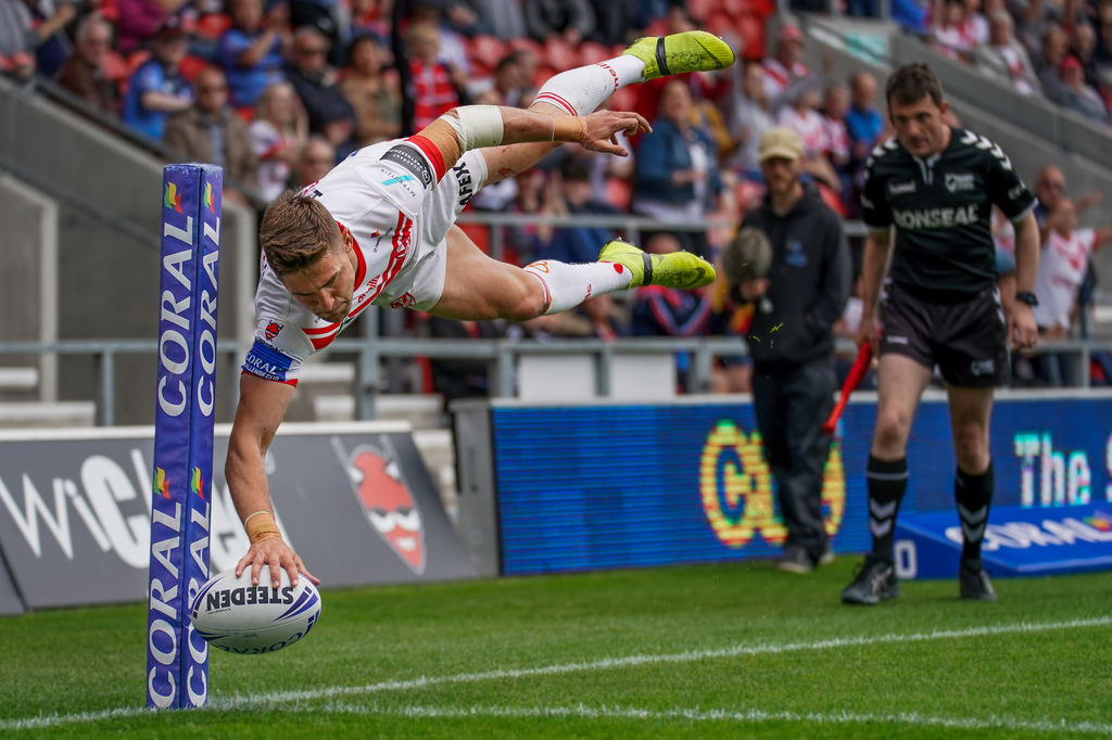 terry-donnelly-sony-alpha-9-rugby-player-leaping-through-the-air-as-he-places-the-ball-down-for-a-try